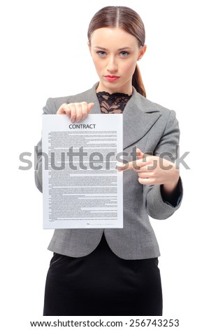 Confident young business woman in formalwear pointing contract paper while standing isolated on white - stock photo