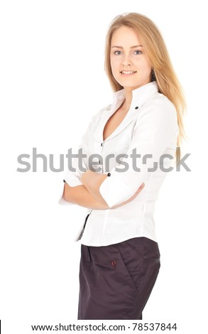 Confident young business woman standing and smiling cheerfully - stock photo