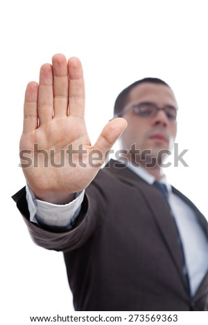 Confident young businessman asking you to stop - stock photo