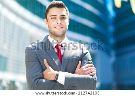Confident young businessman portrait outdoor - stock photo