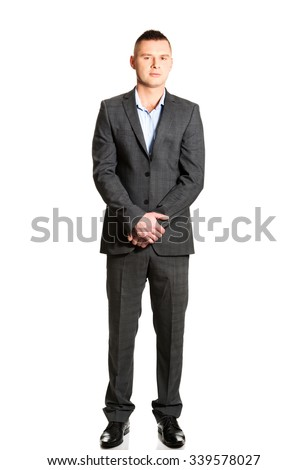 Confident young businessman with clenched hands. - stock photo
