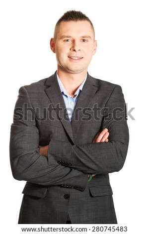 Confident young businessman with folded arms. - stock photo