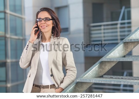 Confident young businesswoman talking on mobile phone. - stock photo