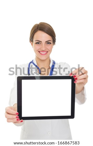Confident young Caucasian brunette female doctor in white coat with blue stethoscope smiling showing tablet computer with blank isolated screen. Copy space available on screen and in the background. - stock photo