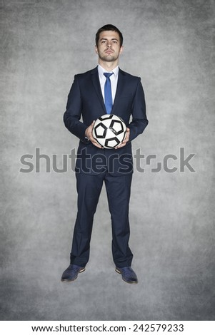 confident young football manager - stock photo