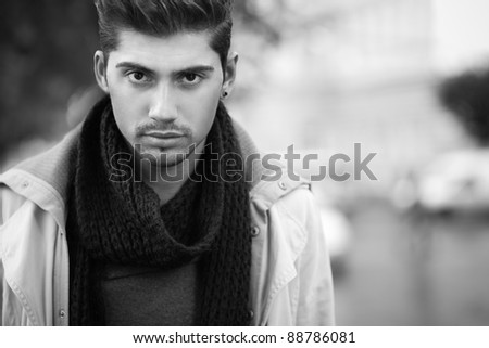 confident young man on street. - stock photo