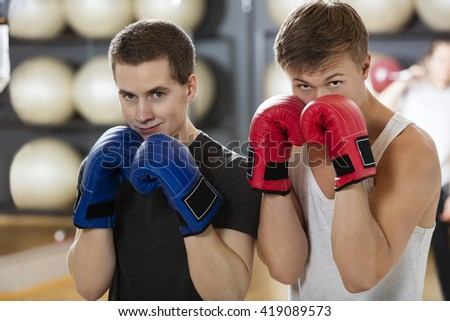 Confident Young Men Boxing In Gym - stock photo