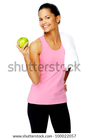 confident young sporty hispanic woman holds a fresh apple after a gym session promoting healthy eating and healthy lifestyle - stock photo