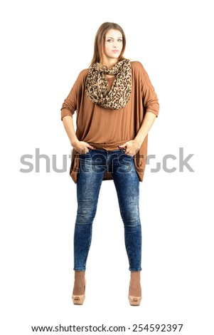 Confident young trendy woman in modern urban fashion. Full body length portrait isolated over white background. - stock photo