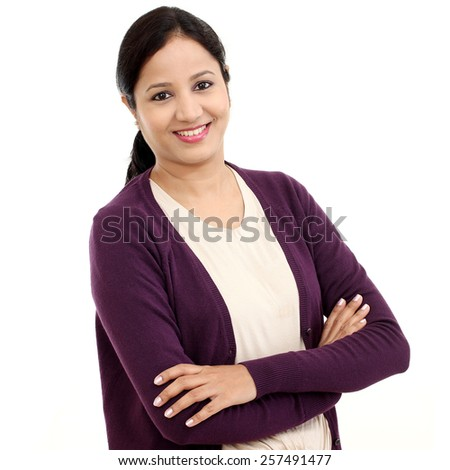 Confident young woman arms crossed - stock photo