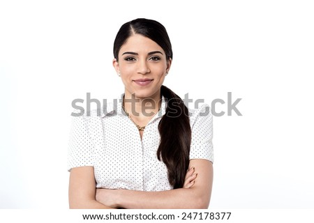 Confident young woman posing casually to camera - stock photo