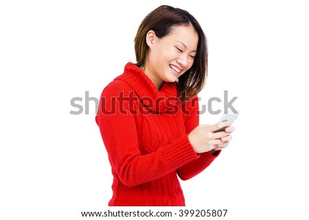 Confident young woman using mobile phone on white background - stock photo