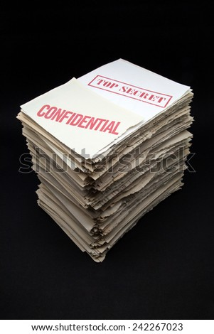 confidential and secret documents on black background - stock photo