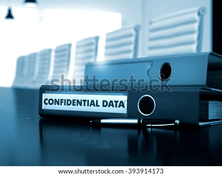 Confidential Data. Concept on Toned Background. Ring Binder with Inscription Confidential Data on Desktop. Confidential Data - Business Concept on Blurred Background. 3D. - stock photo