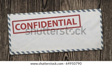Confidential  envelope on wooden background, clipping path. - stock photo