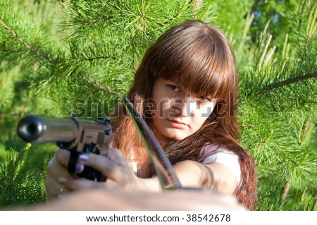 conflict beatween girl with gun and man with sword - stock photo