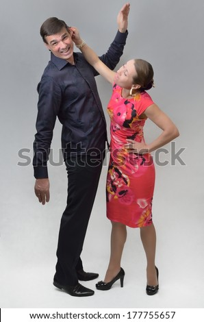 Conflict between man and woman - stock photo