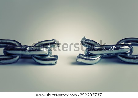 conflict in business concept with broken chain - stock photo