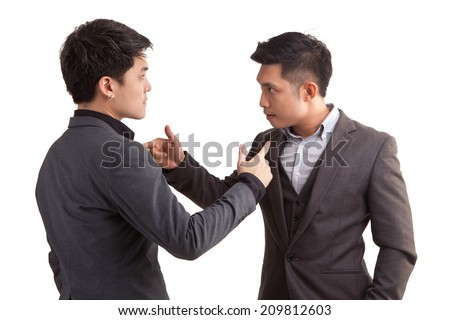 Conflict of two asian businessmen. Isolated on white background - stock photo