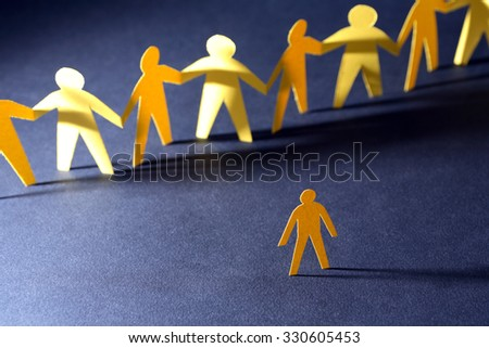 Confrontation concept. Yellow paper man against crowd in a row on dark - stock photo
