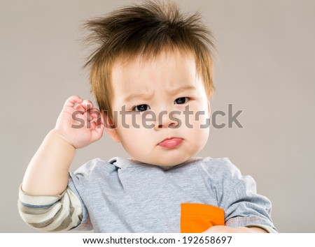 Confused asian baby - stock photo