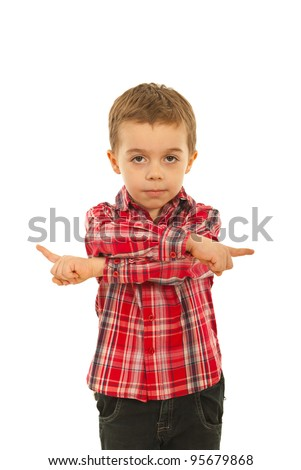 Confused boy pointing in both ways and asking for which direction isolated on white background - stock photo