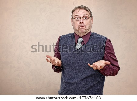 Confused Business Man Shrugging his Shoulders - stock photo