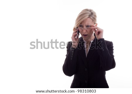 confused Businesswoman with phone - stock photo