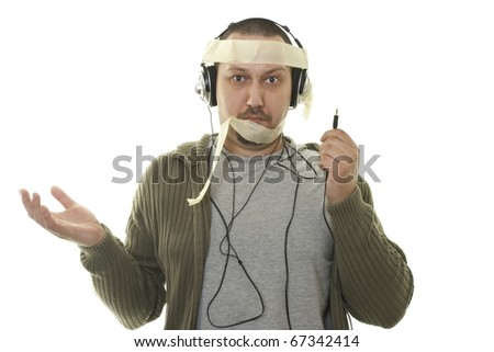 confused caucasian man with headphones  have problems with audio equipment - stock photo