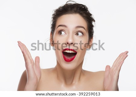 confused girl with red lipstick over white background. - stock photo