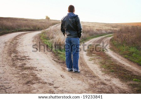 confused person chooses road - stock photo