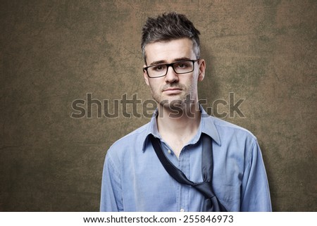 Confused untidy businessman posing, depression and unemployment concept - stock photo