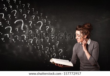 Confused woman reading a book with question marks coming out from it - stock photo