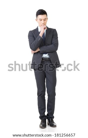 Confused young business man standing and thinking, full length portrait isolated on white background. - stock photo