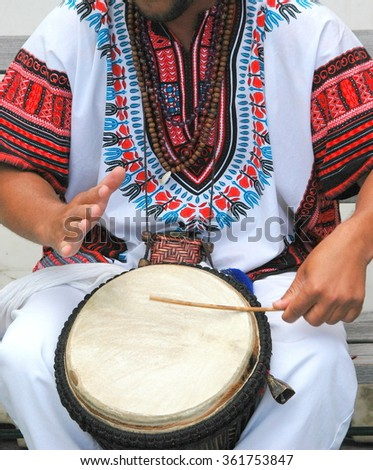 Conga drummer performing in concert outdoors. - stock photo