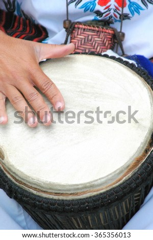 Conga drummer performing in the street outside. - stock photo