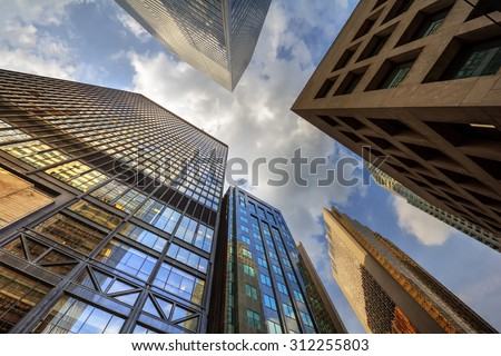 Conglomeration of superstructures against the blue sky - stock photo