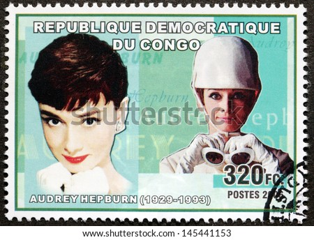 CONGO - CIRCA 2006. A postage stamp printed by CONGO shows image portrait of British and American actress Audrey Hepburn, recognized as both a film and fashion icon, circa 2006. - stock photo