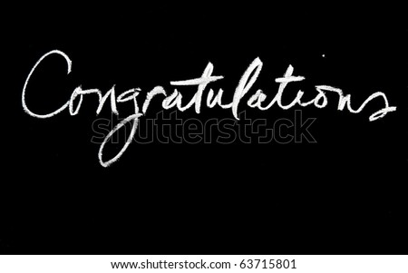 congratulations handwritten in script in chalk on a blackboard - stock photo