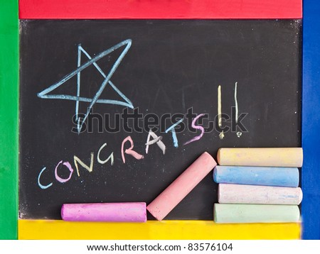 Congratulations written on a blackboard - stock photo