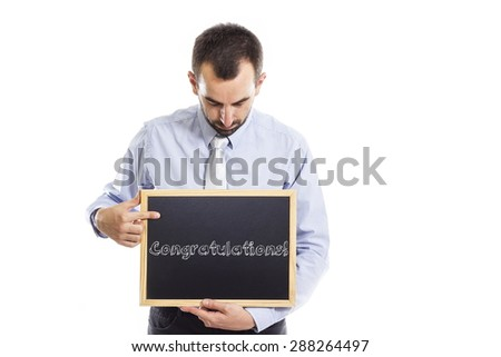 Congratulations- Young businessman with blackboard - isolated on white - stock photo