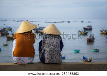 Conical hat - Mui Ne Fishing village. Viet Nam - stock photo
