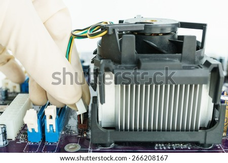 connect heat-sink connector on main-board - stock photo