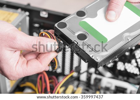 Connect the hard drive to the computer. - stock photo