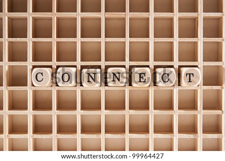 Connect word construction with letter blocks / cubes and a shallow depth of field - stock photo