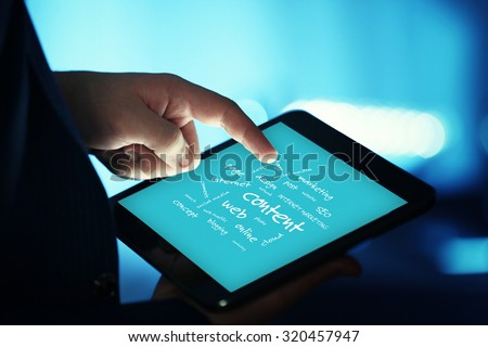 Connected words on touch-screen tablet-pc - stock photo