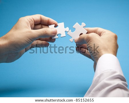 Connecting puzzle - stock photo