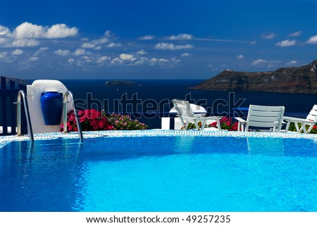 connection between blue color on the pool and sea - stock photo