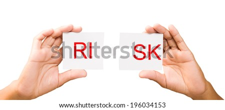 connection concept. hands with pieces of puzzle on white background, clipping path. RISK - stock photo