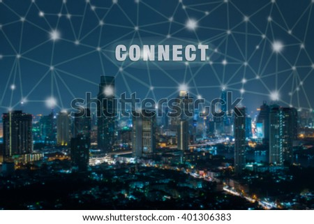 connection font on blue tone city scape and network connection concept - stock photo